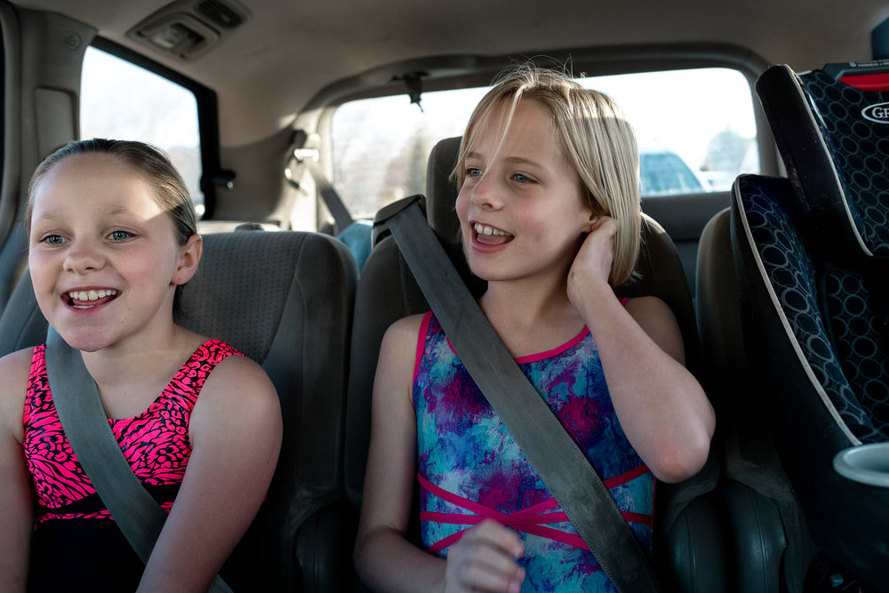 Tweens singing to Tay-Swift on the way to gymnastics.