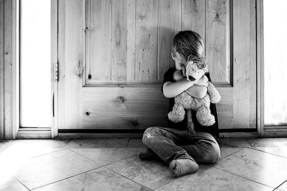 Little boy hugging stuffed animal - Family photography Utah