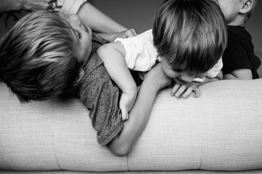Boys rough housing on bed - Utah family lifestyle photographer