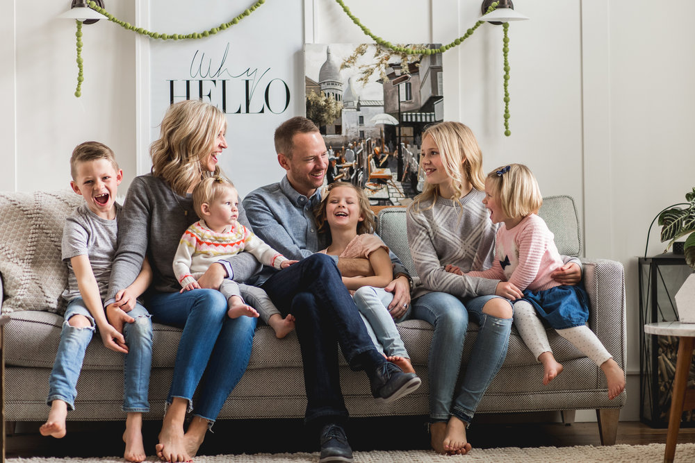 Family laughing on couch - Utah Lifestyle Family Photographer