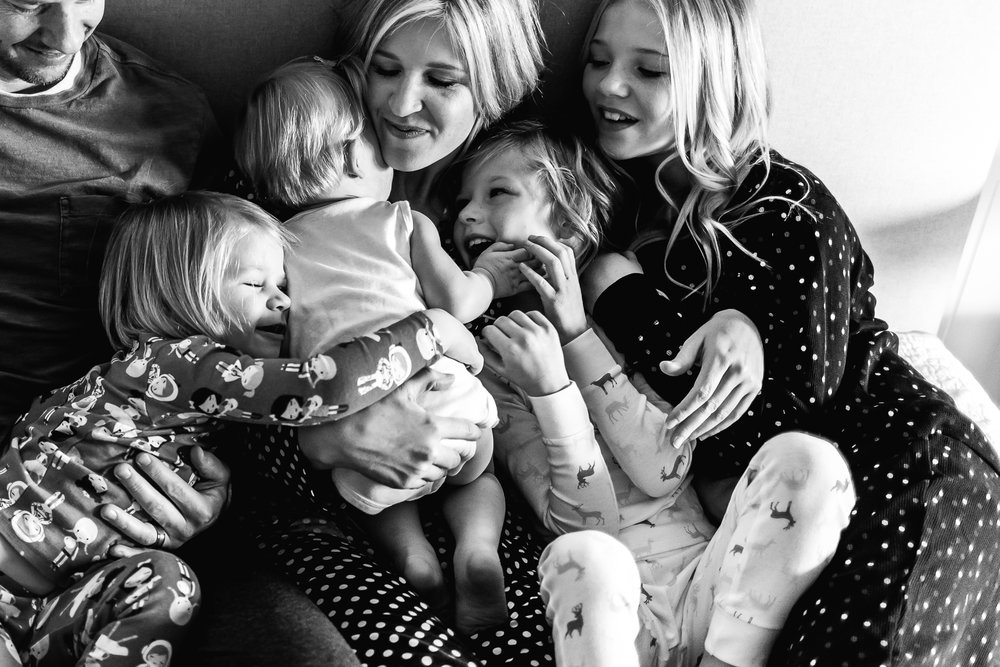 Mom and dad snuggle all their daughters - Utah family photographer