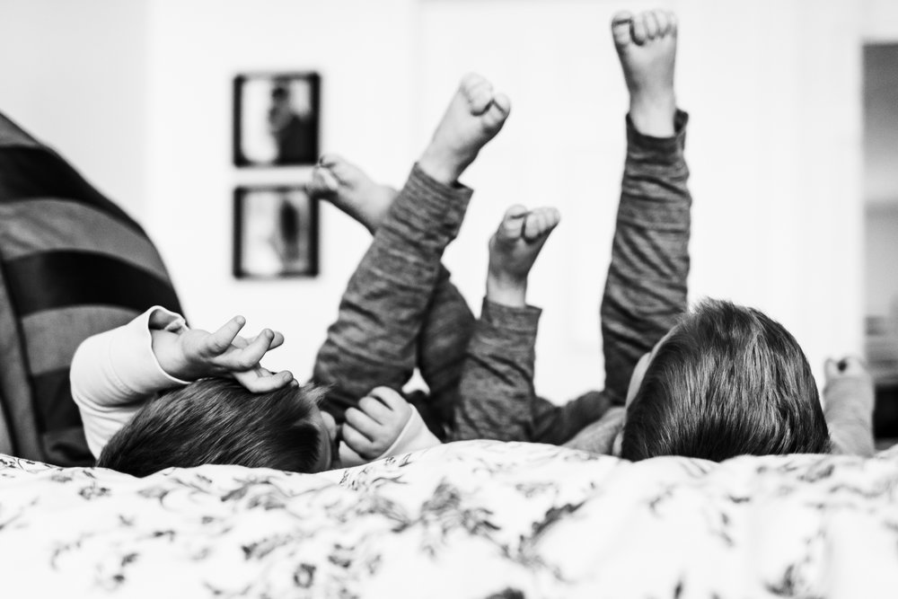Twin brothers with feet in air - Utah lifestyle photographer