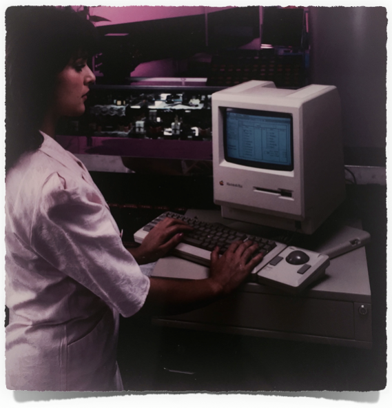 Co-founder Renee Maple operating an early version of STX on a first-generation Mac in the 1980s.