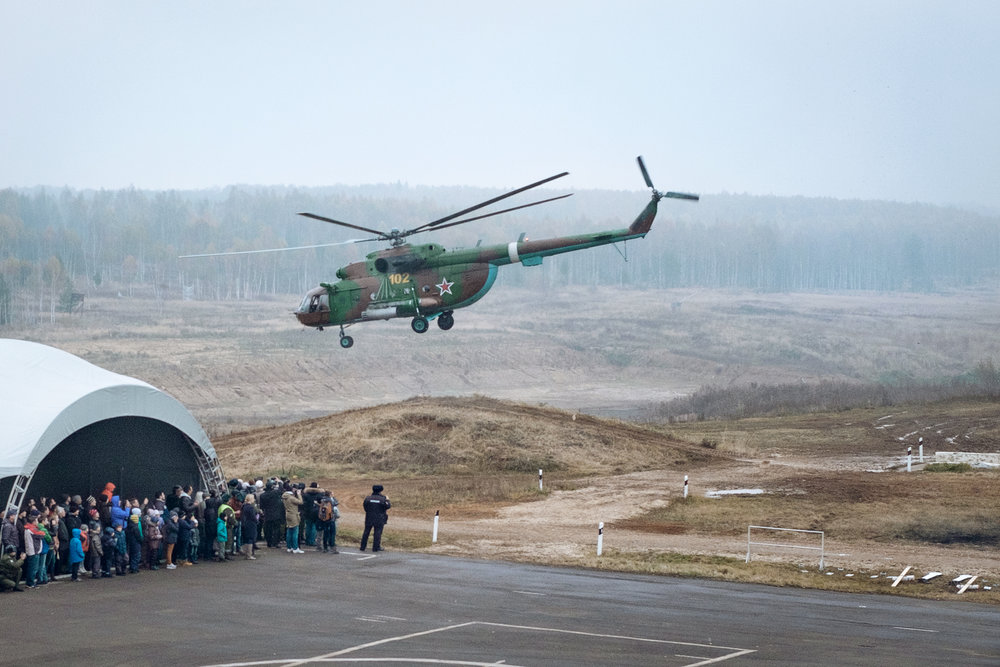 """A Russian Mi-8M transport helicopter at the live demonstration program during the 19th homeland security exhibition """"INTERPOLITEX"""". Military base, Russia,2015."""
