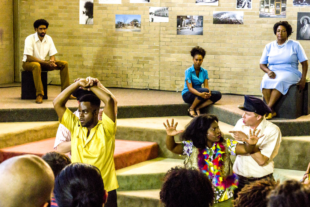 Organizing in response to the July 5, 1963 police killing of Cynthia Scott, a 22-year-old Black woman who engaged in survival sex work, demonstrates the police brutality that ignited the '67 rebellion had a long history and knew no bounds. Actors (foreground L to R): Johnathan Finch, Brandon A. Wright, Kristy Allen, Nick Stockwell; (background L to R) Kyle Sammy, Coda Boyce and Deborah Chenault Green. Photo credit: Mark Sullivan (7/28/2017)