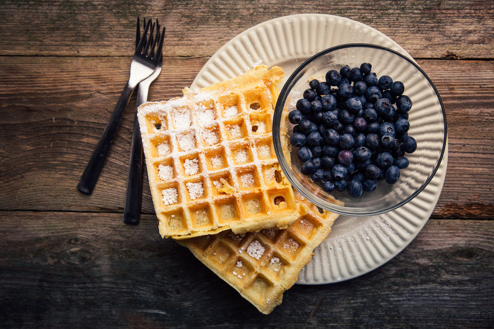 Belgian waffles and blueberries. Studio lighting.