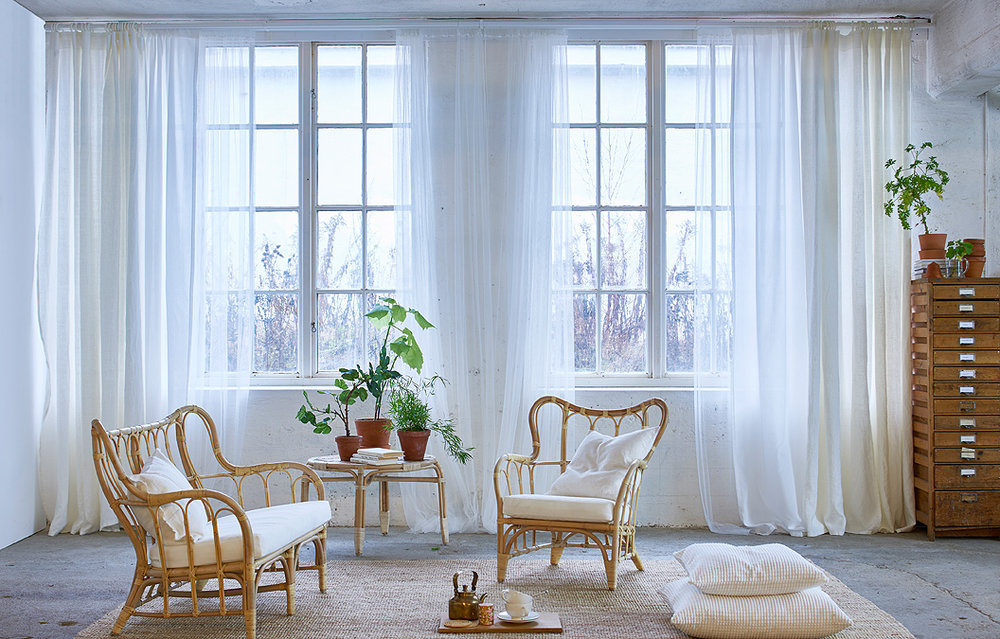 - I'm a big fan of IKEAs textile department. I have these sheer curtains in white and I use them for everything! Photo props, Christmas tree skirt and of course, as actual curtains.
