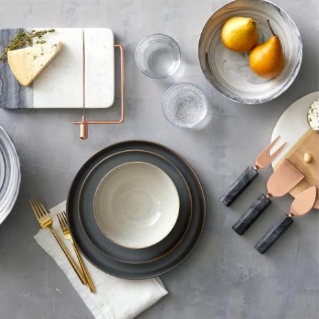 Dinnerware clockwise as shown: Marble Cheese Slicer $19.99, Porcelain Serving Bowl $16.14, Cheese Knife Set - Copper $16.99, Tiley Stoneware 16pc Set $59.99,Izon 5 pc Silverware Gold Set $19.99