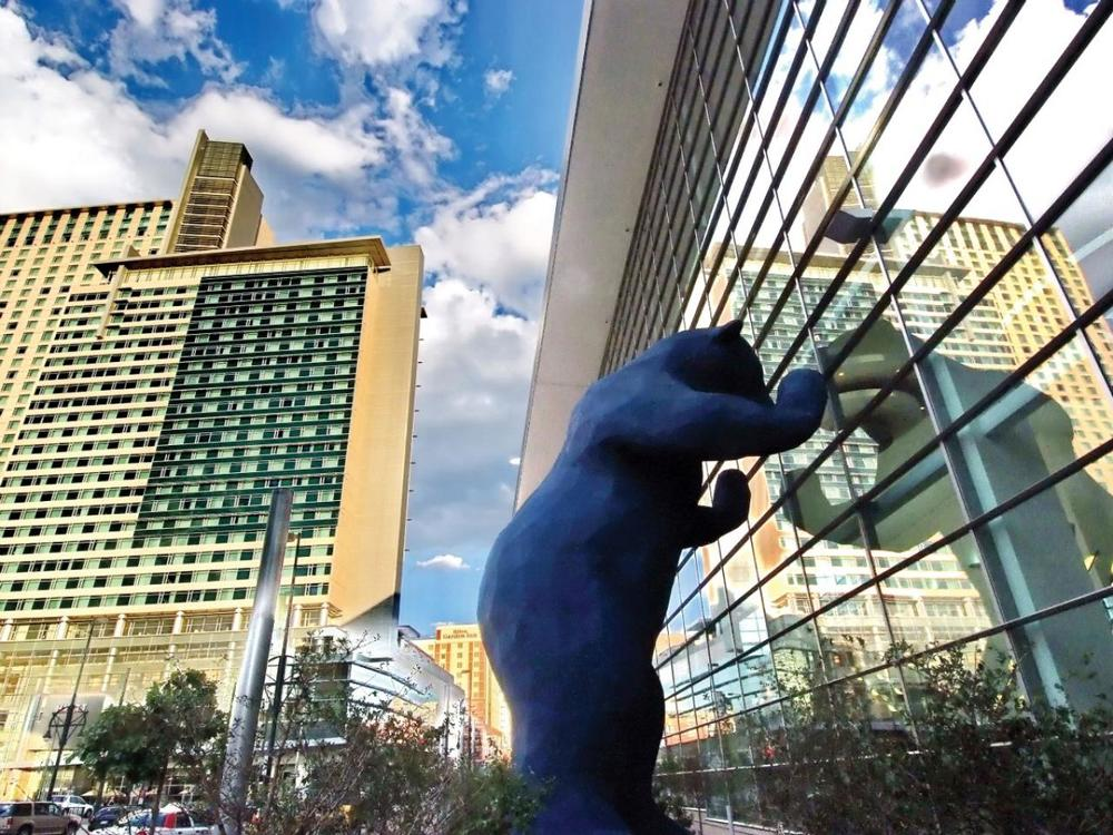 Artists Lawrence Argent's Blue Bear staring into the Colorado Convention Center. Image courtesy of denverconvention.com