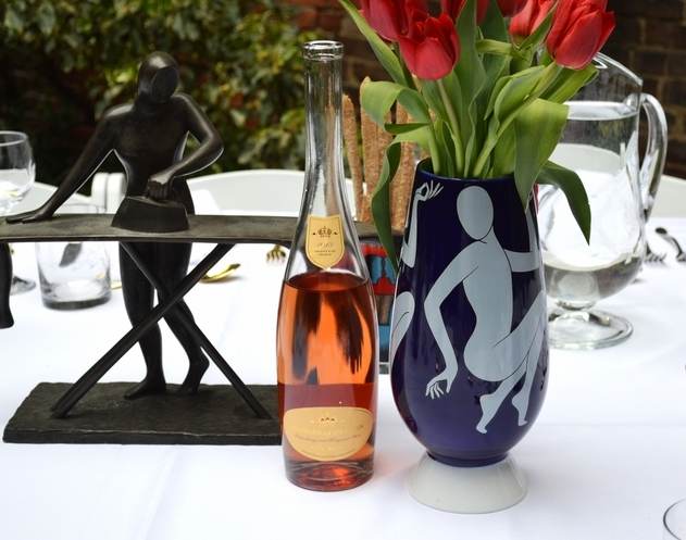 An open bottle of Bodvàr of Sweden rosé on a Victory Club tablescape