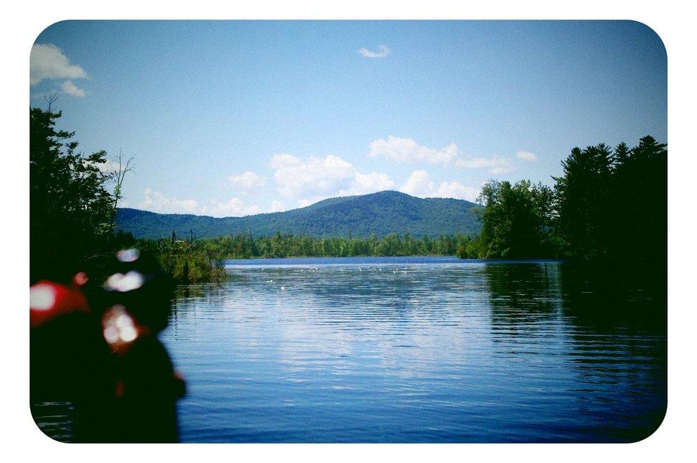 a shallow lake amongst mountains