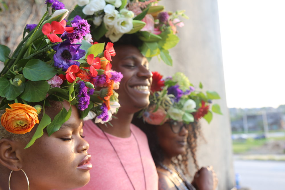 "Image from the ""Flowers on Your Head"" fundraiser for Tha Flower Factory.  Pictured: Jenné Afiya, Gregory Brown Jr., Tracey Beale"