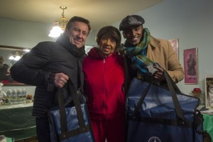 Chefs Marcus Samuelsson and Daniel Boulud celebrate Citymeal's' Chefs Deliver by bringing members of the Harlem elderly community freshly prepared meals.
