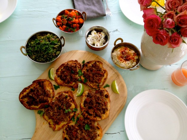 Traditional pizza gets a spicy and ethnic kick served with a side of tabouleh.