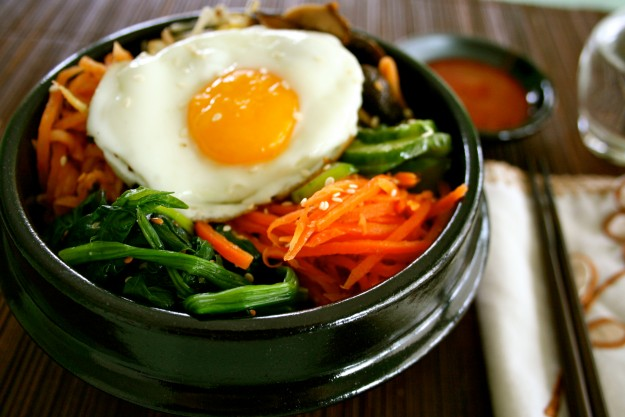Korean bibimbaap is served up hot in a stone pot.