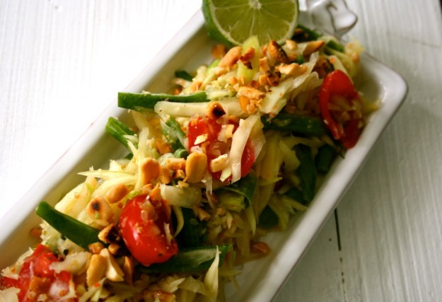 Thai Green Papaya salad gets its crunch from fresh produce and a sprinkling of yummy peanuts.