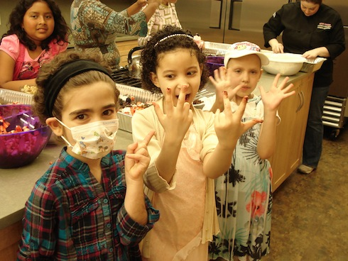Joely, Antoinette & Ashlynn learning that decorating cakes can be a dirty job!