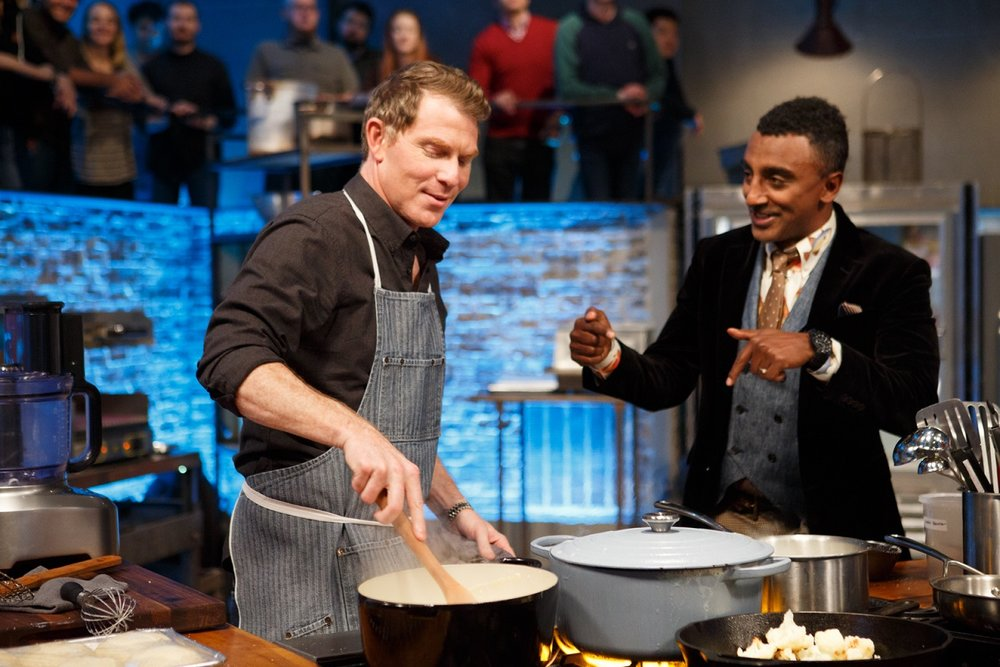 Marcus checks in with Bobby cooking.jpg