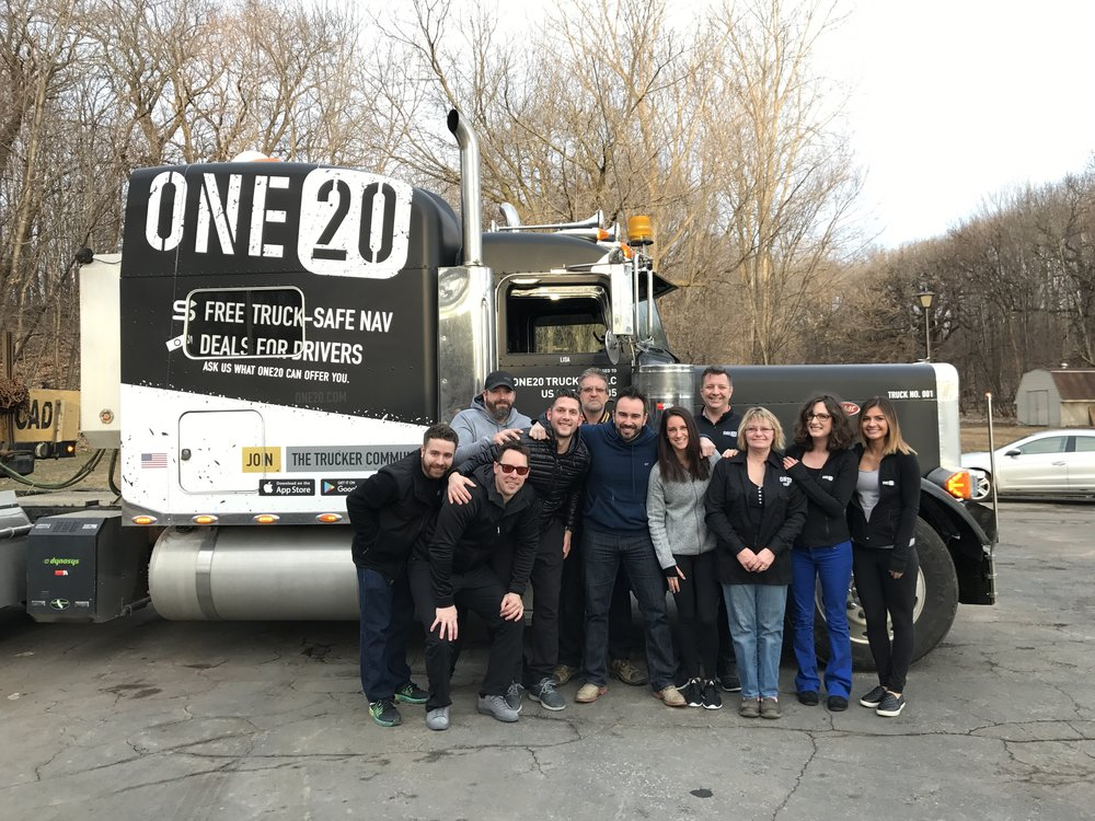 A group picture of the One20 team with the official One20 truck  That's Christian, the CEO front and center hugging his fantastic group of team players.