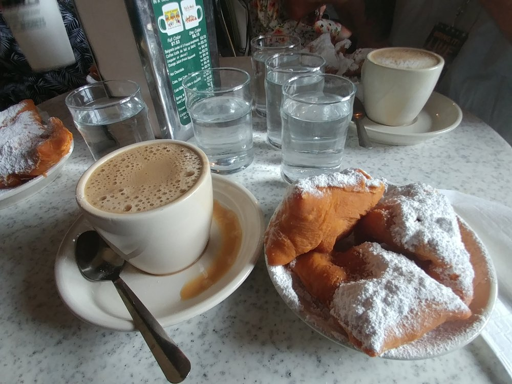 Cafe au Lait and Beignets at Cafe du Monde in New Orleans.  Look at all that powdered sugar!  How can you NOT make a mess, lol.  I can't anyway.
