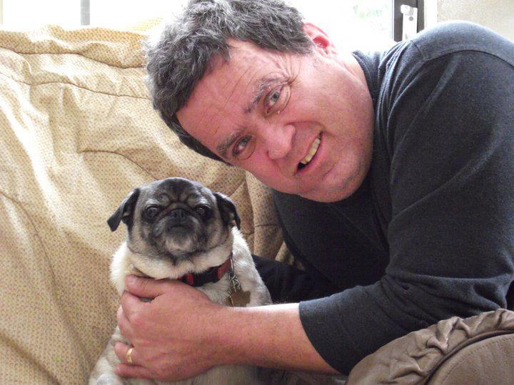 What's not to love about pugs!  Mark with his beloved pet.