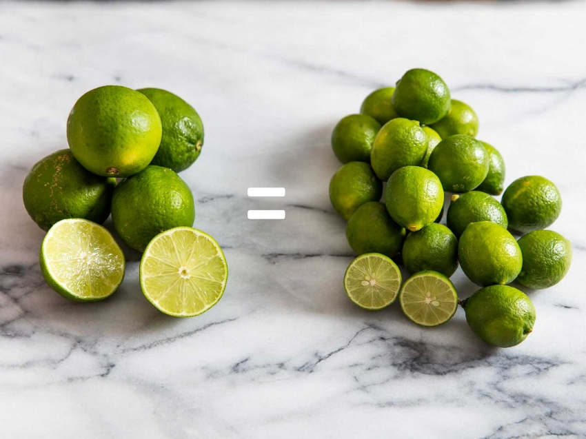 Size comparison of regular or Perisan Limes on the left and Key Limes on the Right.  You can see where the Key Limes are starting to turn yellow in some spots, which means they are getting ripe.