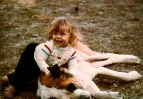 I was about 2 here.  This was our St. Bernard, Roxy.  I used to ride her around our yard like a horse.  She was the most gentle thing in the whole world.