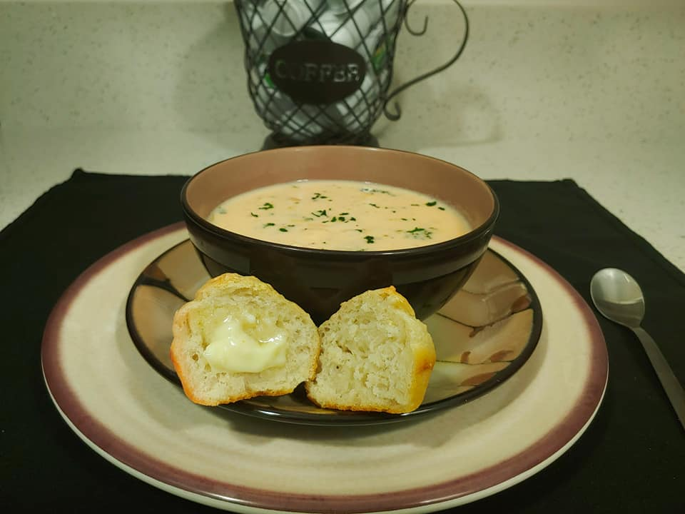 Broccoli and Cheese soup served hot with a side of homemade peasant bread hot from the oven.