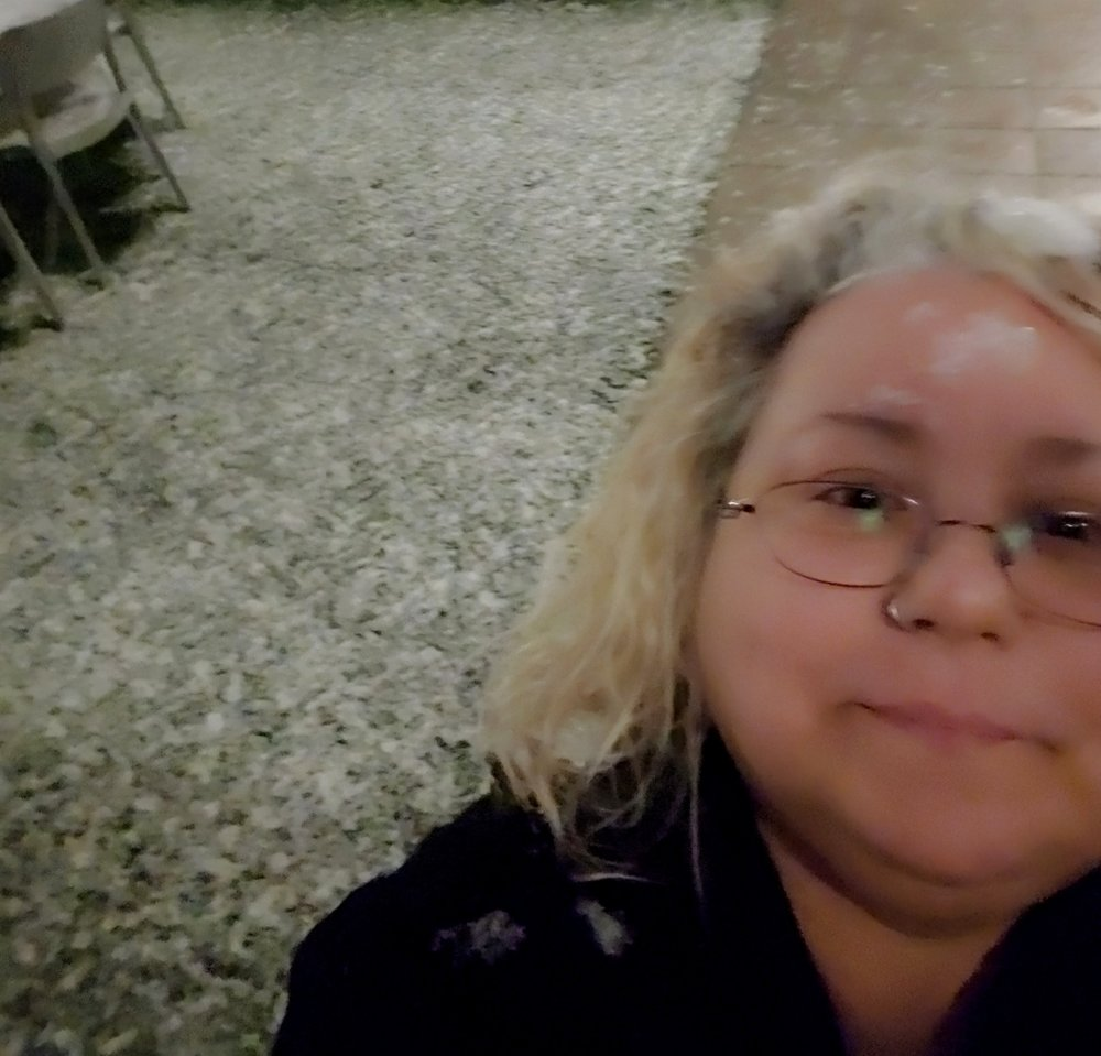 Braving the freezing temperatures in usually warm and sunny Las Vegas to get a picture when a big, fat, snowflake attacked me. See, right there! I have evidence of the chilling attack. There once was a girl with a little curl… uh, snowflake, right in the middle of her forehead.