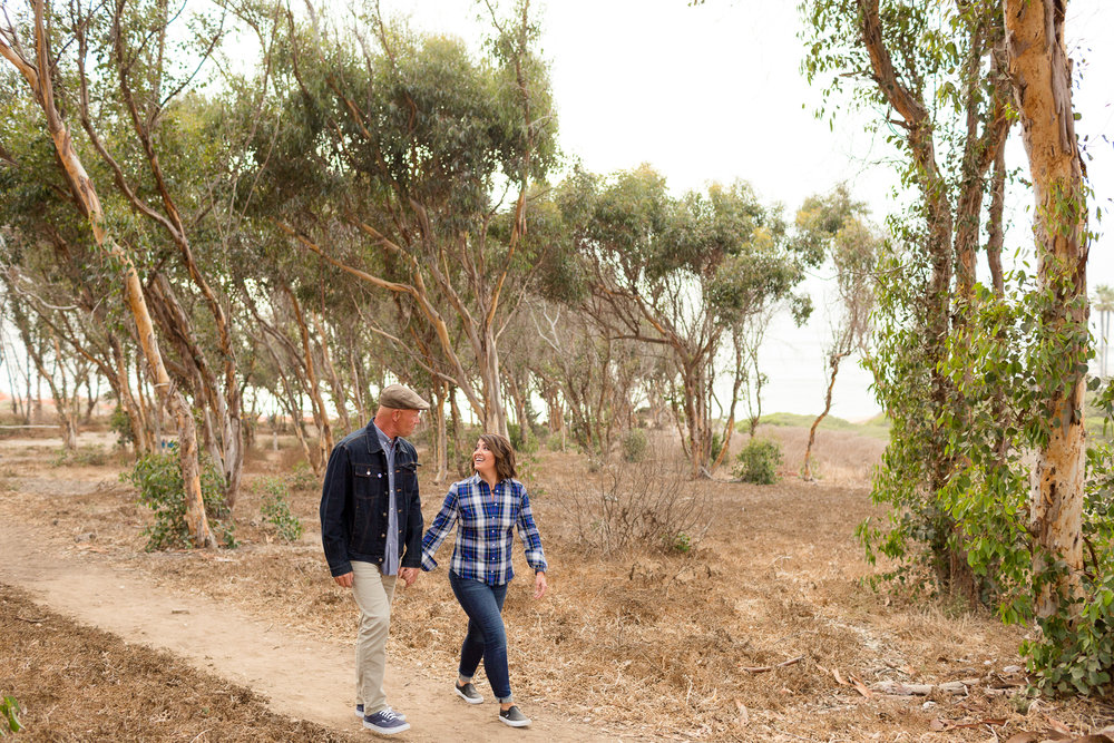 couple walking through eucalyptus grove