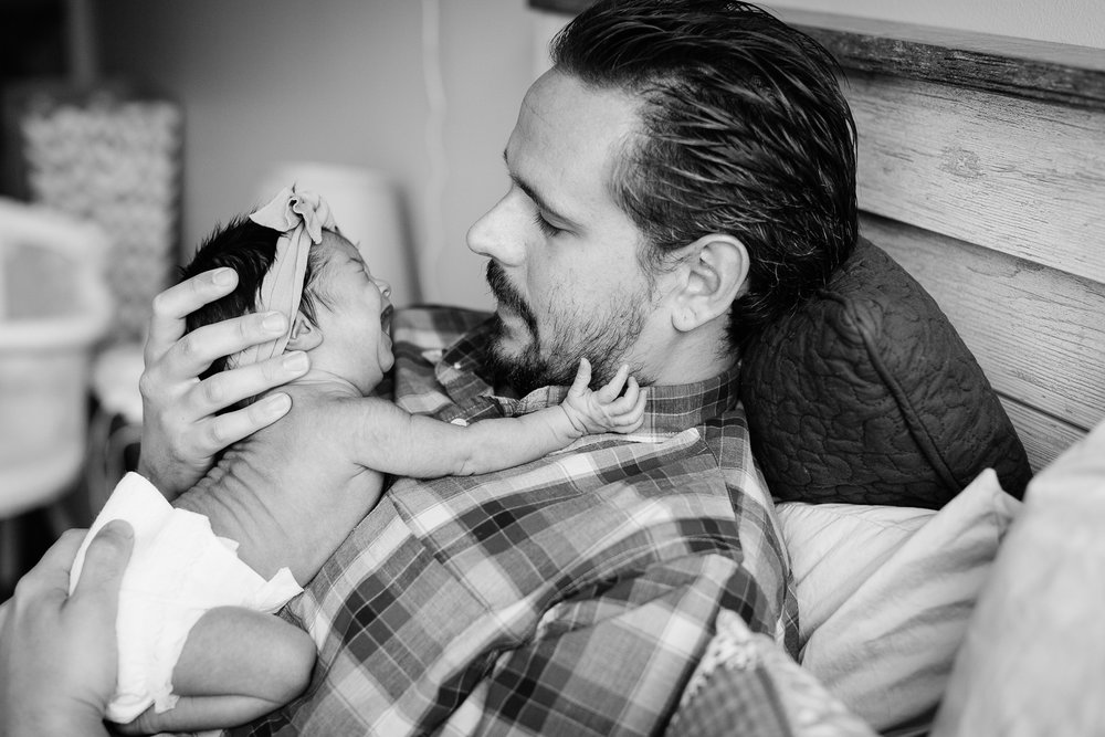 San Diego Newborn Photographer Christine Dammann Photography lifestyle newborn family on bed 4