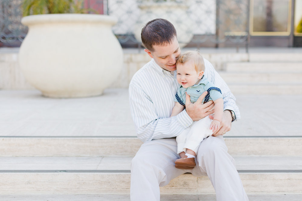 dad and son hugging on steps
