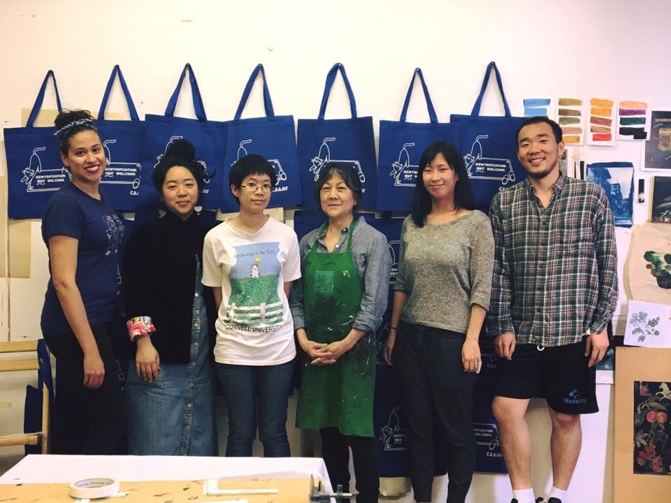 "Chinatown Art Brigade co-founder, Tomie Arai with volunteers create CAAAV ""Here to Stay"" tote bags"