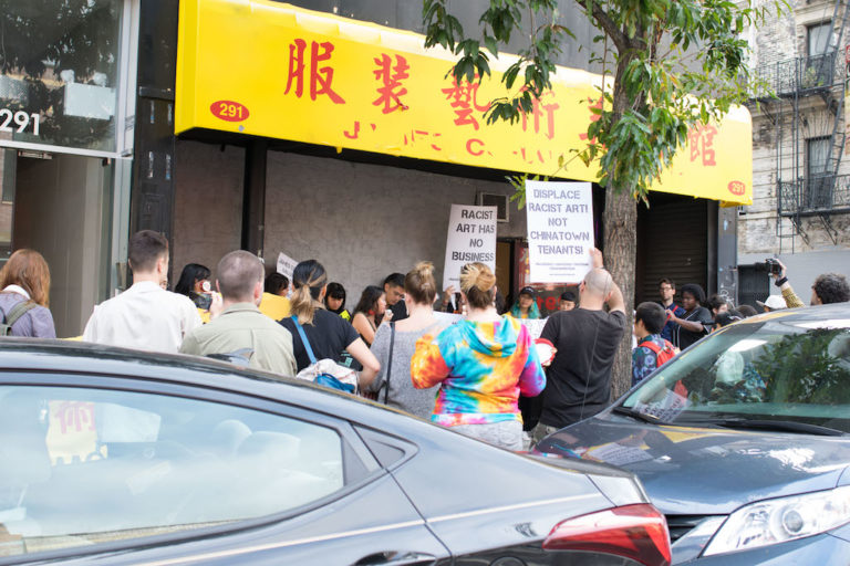Protestors outside James Cohan Gallery's Chinatown space yesterday. Photo: KahEan Chang