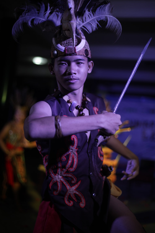 Dayak male dancer in Indigenous Lead celebration night.