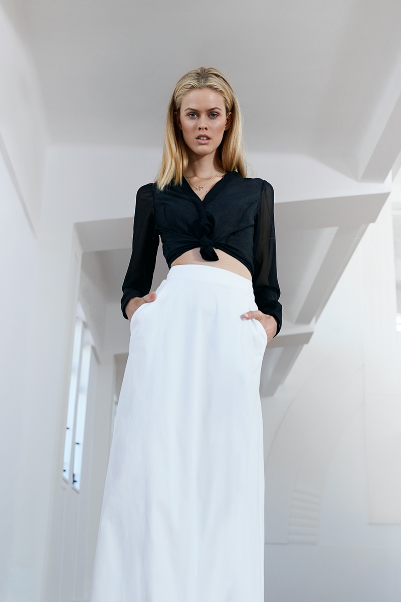 Black chiffon shirt,  Lara Klawikowski ; white skirt,  Amanda Laird Cherry ; gold necklace,  Famke