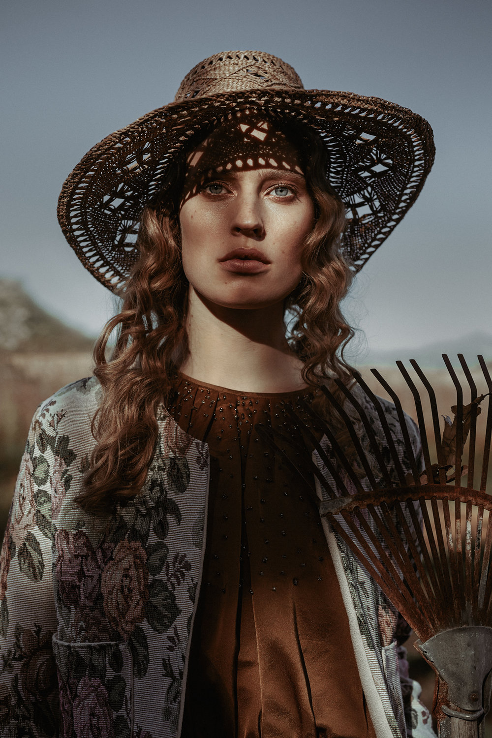 Gold silk blouse with bead detail, Babette; floral tapestry jacket, Tarynella available at Babette; straw hat, stylist's own