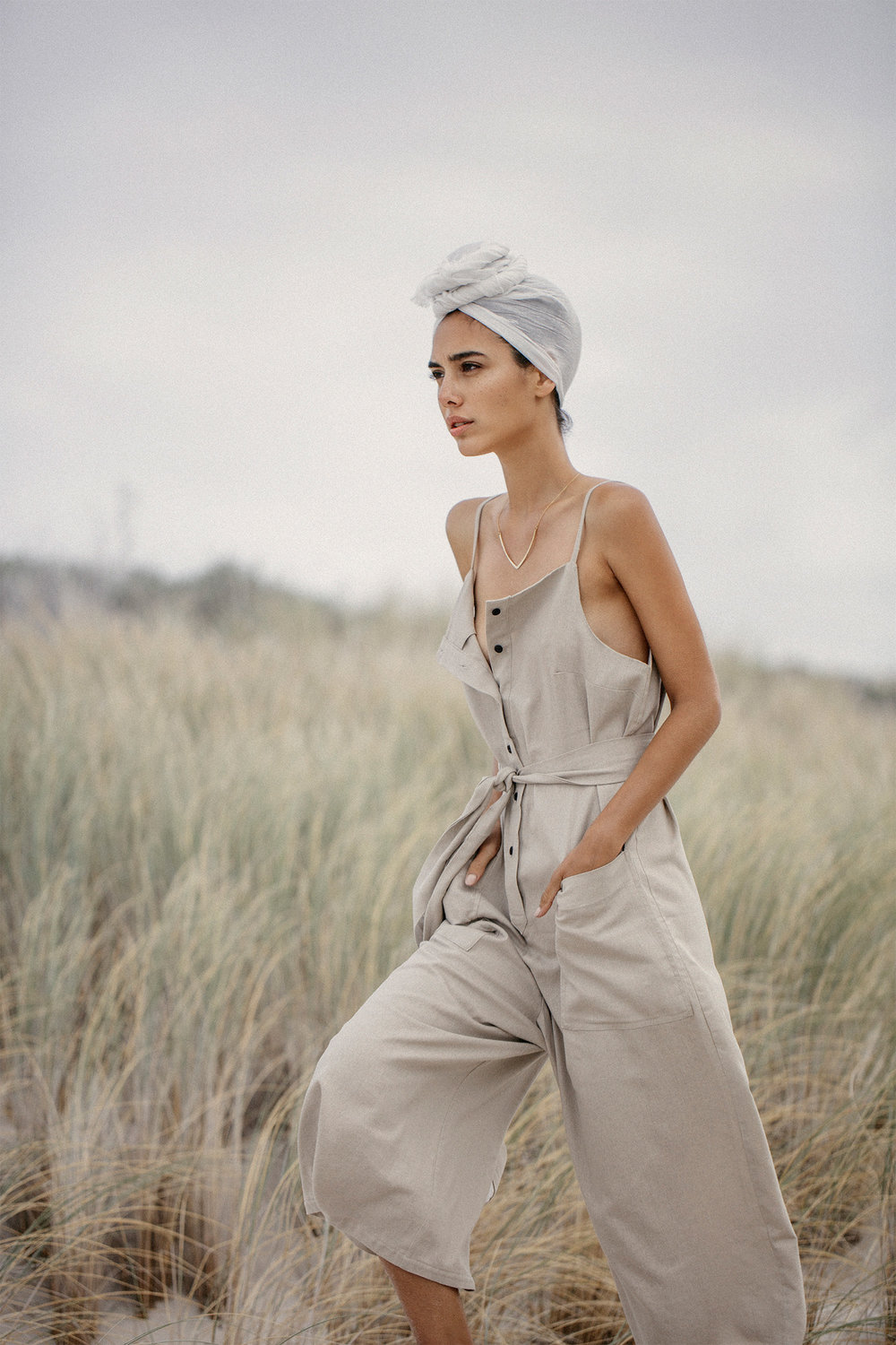 Beige jumpsuit, Selfi at Mungo & Jemima; necklace, Sarah Mulder Jewelry; head wrap, stylist's own