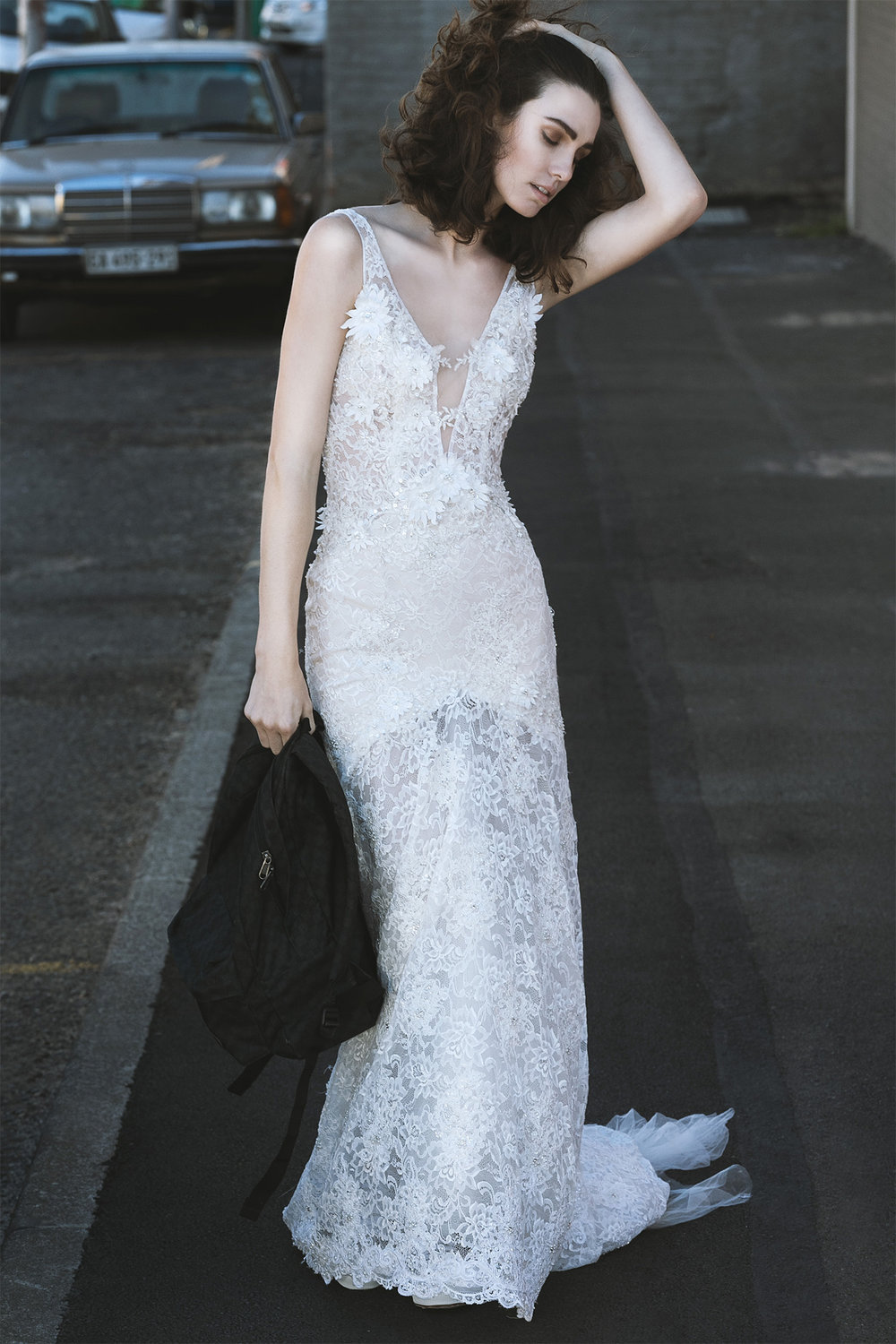 Vintage lace gown with 3D flowers and sheer low back, Cindy Bam; bag, Vans