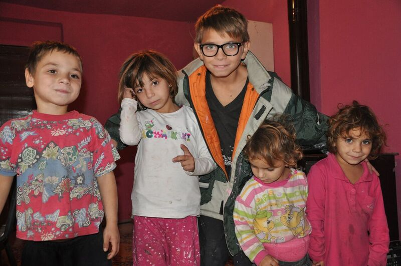 Laurențiu and his younger siblings in their home.