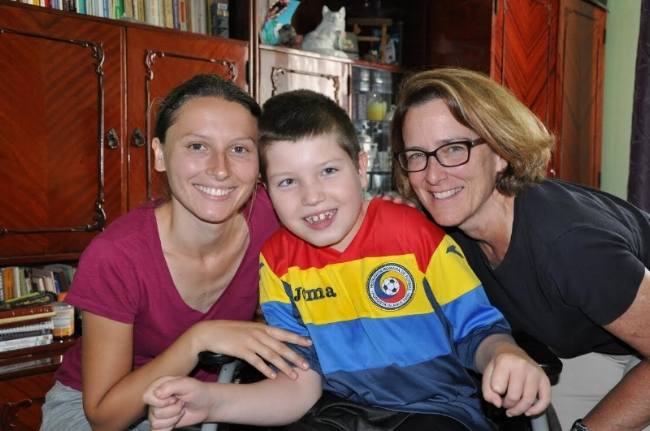 Marti (R) with Natalia (L), the physical therapist at the Darius Houses, with one of RCE's recent Walkathon/Fun Run guests, Florinel.