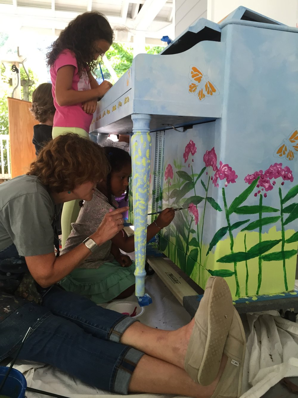 Springmont school art teacher, theresa dean (and students), painting 'carly' for the woodruff arts center.