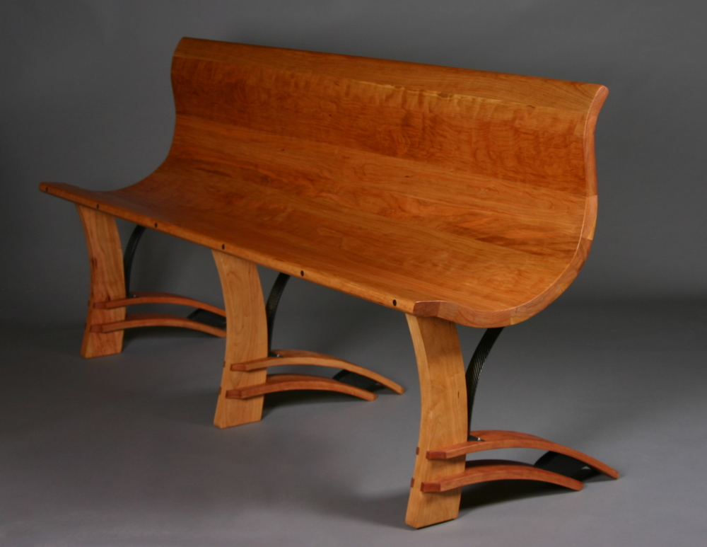 Bench No. 60, cherry, carbon fiber. 6'x2'x3'. $6,500.
