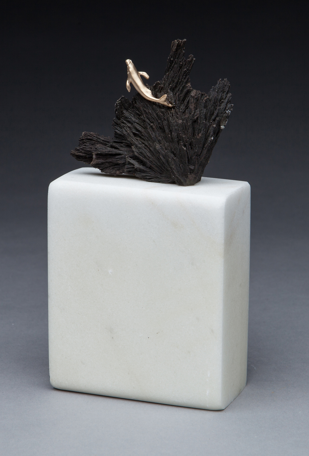 "Poetry in the Sea, 14k on alabandite. 7""x3""x2"". $1,475."