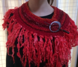 Woven Cape on 450mm loom, using handspun yarn and tail spun yarn for the fringe.   All fibres were dyed using The Wheel Ewe Non-Toxic Dye range.