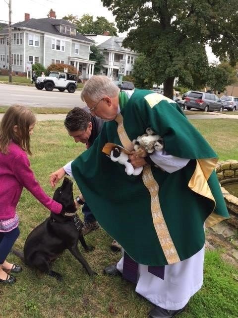 Larry blessing animals.jpg