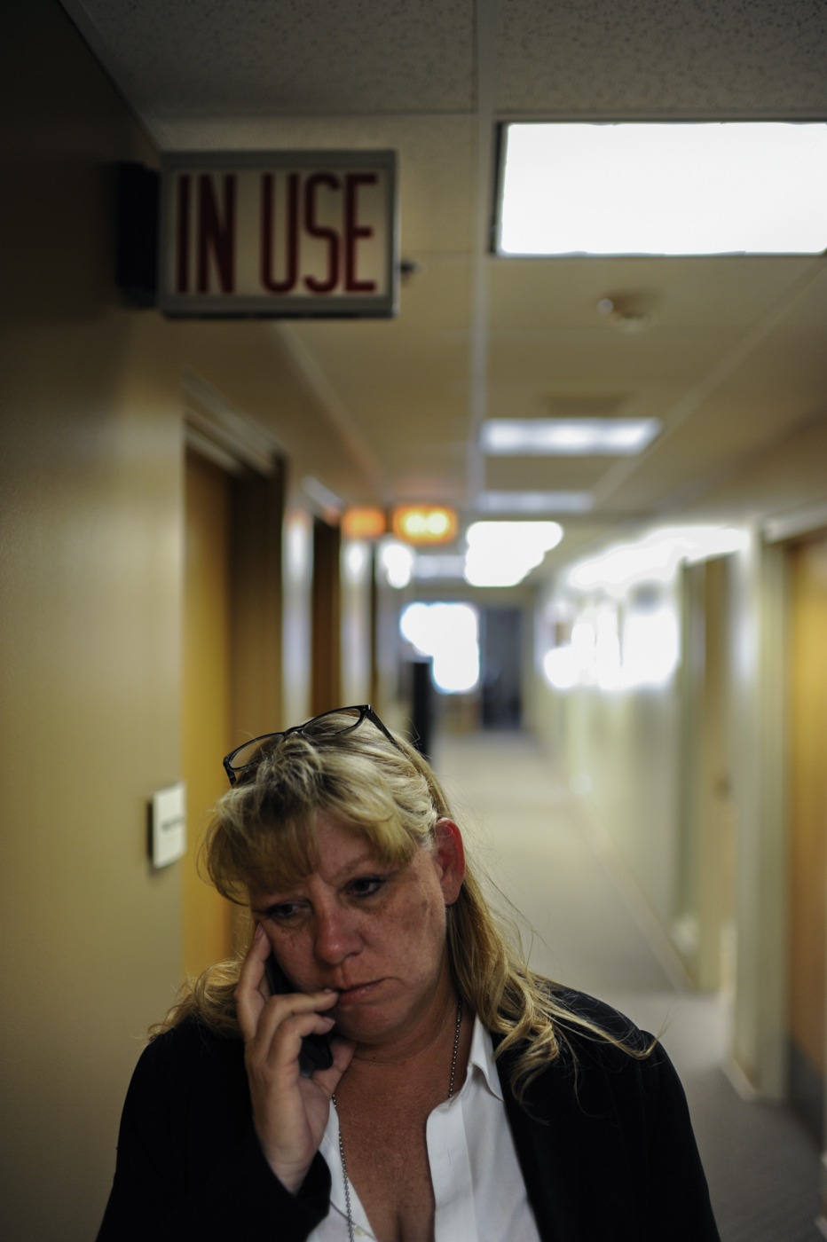 Passing the suspect interview rooms in the Platte County Sheriff's station, detective Nancy Penrod calls home.