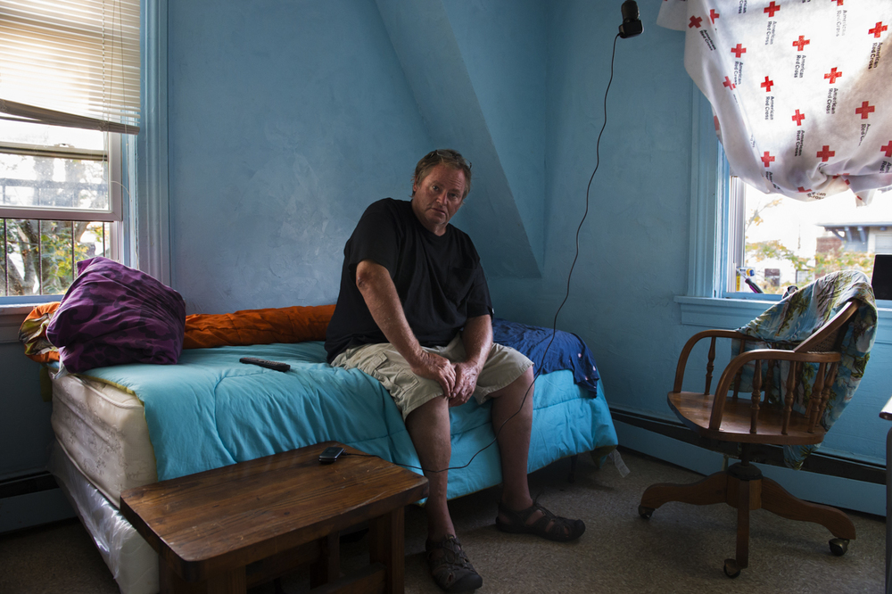 James Culleton relaxes on a late summer 2013 afternoon in his temporary home, a room in a single room occupancy residence in Rockaway Park.  Despite the significant downgrade in accommodation, it is the first time since Superstorm Sandy hit that he can afford to have a place of his own. The SROs that still exist in Rockaway represent a bleaker side of the vibrant Rockaway beach community.