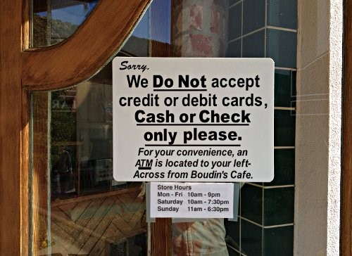 Cash only sign outside of a small, local store
