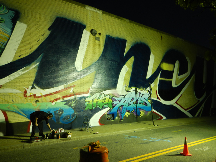 Artists working on the exterior mural.